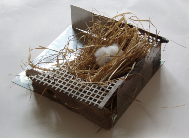 NEST II., 2006-10, sheet steel, grass, plastic wool, wood, 42x33x15 cm